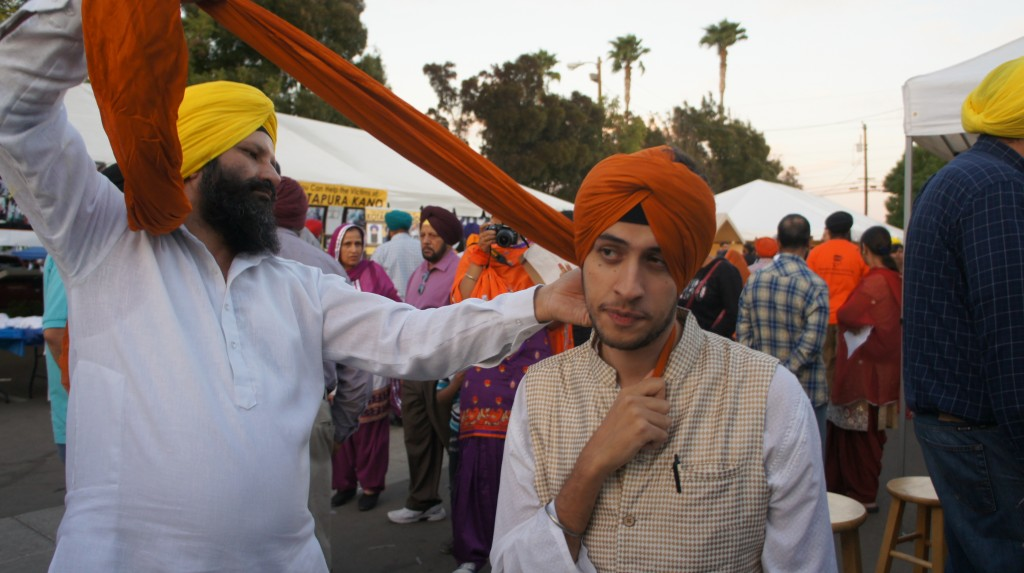 Me, getting a turban tied. Directly behind me is Tejinder, sporting her remarkably fly orange-and-purple suit.