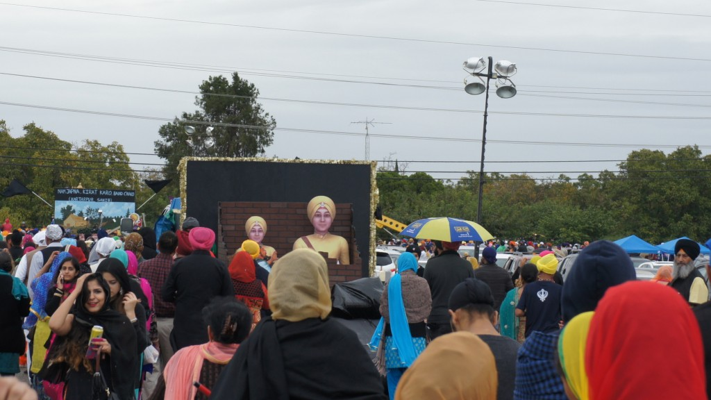 A float showing cardboard cutouts of Jorawar and Fateh Singh being encased in a cardboard brick wall.