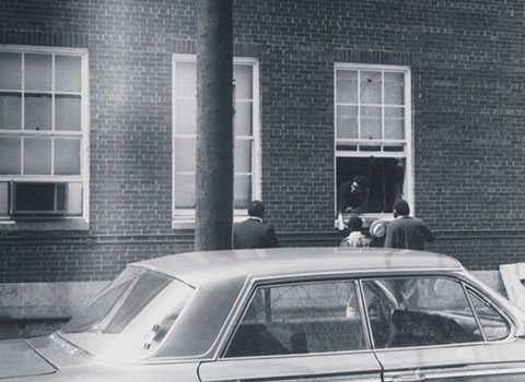 Takeover participants entering and exiting the Bursar's Office through the window, May 3, 1968