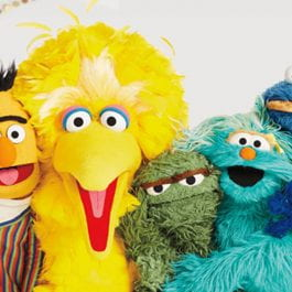 Ellen Wartella's policy-oriented research of Sesame Street is highlighted