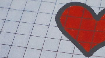 drawn red heart on graph paper