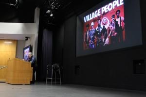 Gayle Rubin giving her keynote. Image of the Village People
