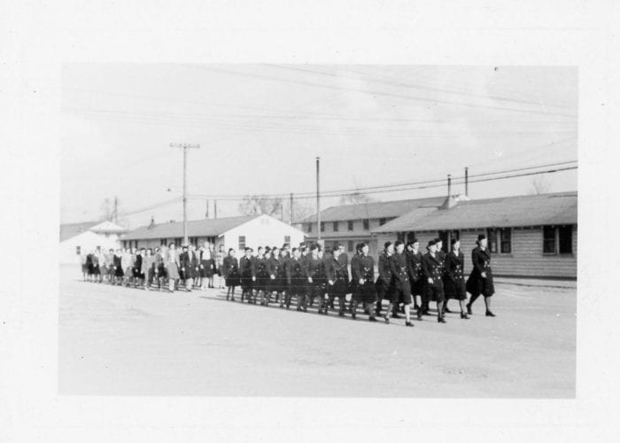 Women in uniform marching at Fort Custer