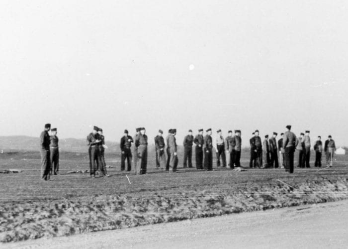 Men doing exercises at Fort Custer