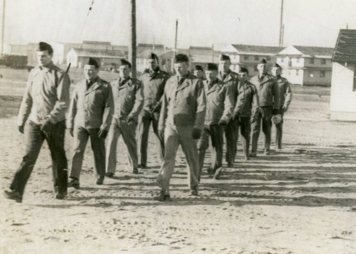 Men marching at Fort Custer