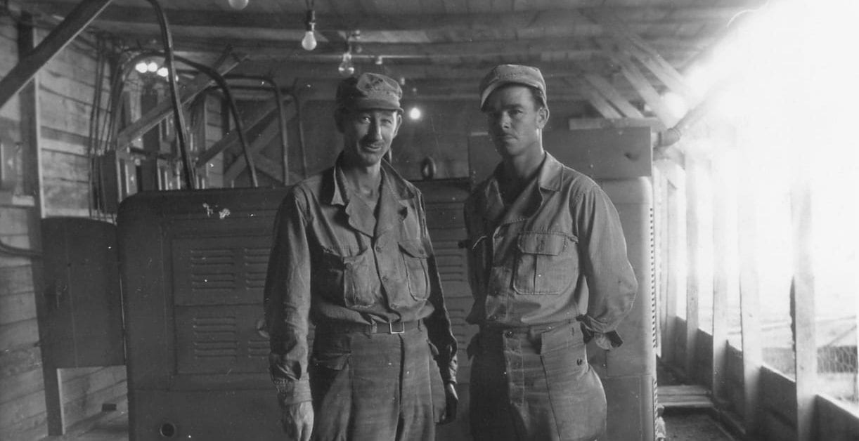 Two enlisted men who worked with utilities standing together