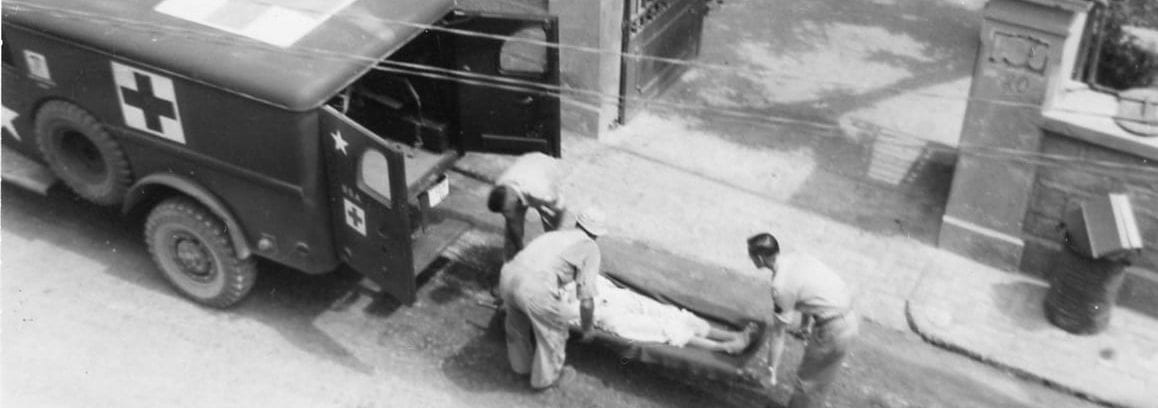 Loading a patient into an ambulance after receiving an x-ray at Ain-el-Turck