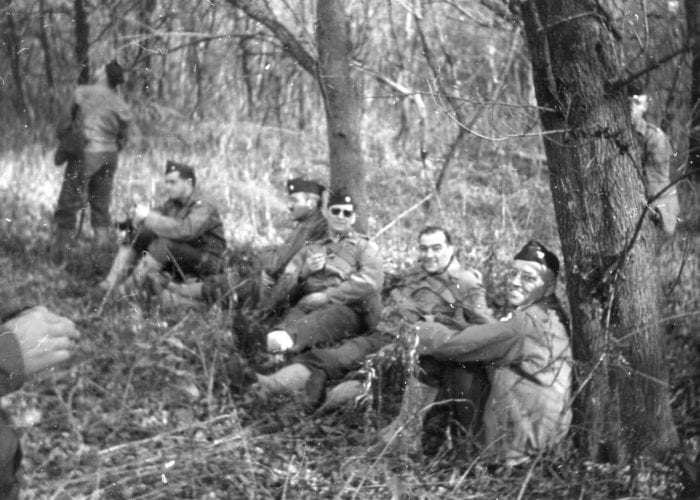 Soldiers resting at Fort Benjamin Harrison in the woods