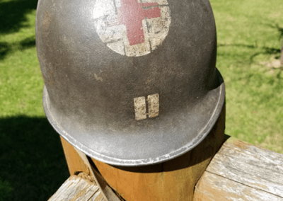 Steel pot helmet of Charles C. Talbot with a red cross on it