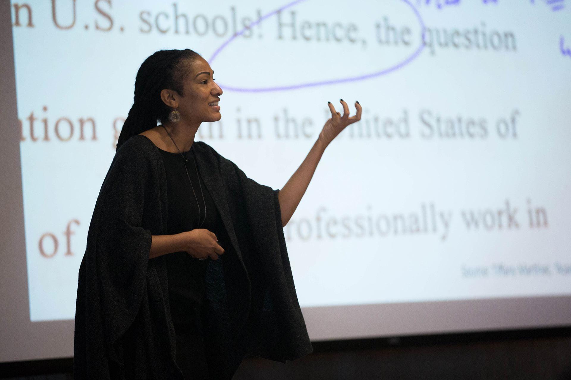 Keynote speaker Ruha Benjamin speaks before the TEACHx audience.