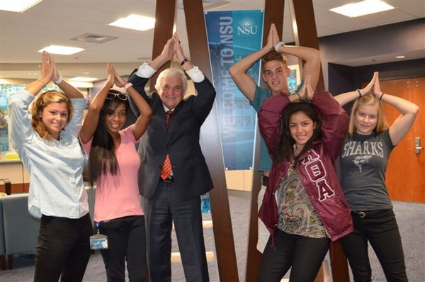 NSU President/CEO George L. Hanbury II and students are proud of being Sharks.