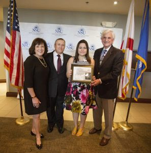 Helen Villarreal, winner in the Art Category, is congratulated by Barbra (left) and Craig Weiner, of the Holocaust Learning and Education Fund, and NSU President George Hanbury.