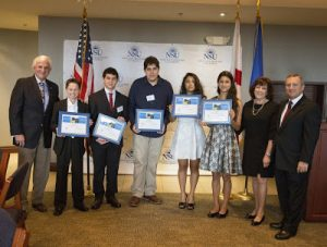 NSU President George Hanbury (left) and Barbra (second from right) and Craig Weiner, of the Holocaust Learning and Education Fund, congratulate winners in the statewide writing, essay and artwork contest commemorating the Holocaust. They include (from l. to r.): Elijah Bishop, Garrett Gold, Ariel Desler, Dominique Deer and Nina Gulati.