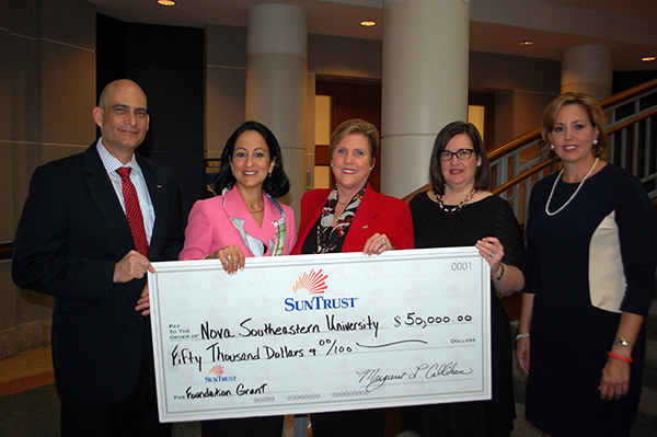 Margaret Callihan, president and CEO of SunTrust and David Ross, senior vice president and relationship manager of SunTrust presented a $50,000 donation to Jacqueline A. Travisano, Nova Southeastern University executive vice president and COO as part of their larger investment in the university