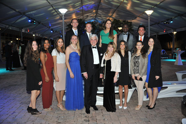 NSU President Dr. George Hanbury and Jana Hanbury surrounded by NSU's President's 64 Students