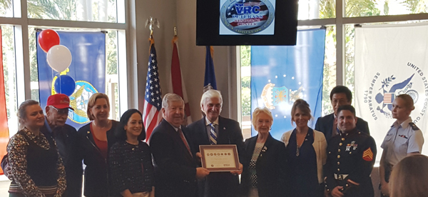 NSU President Dr. George Hanbury, center, poses with guests and officials to receive the Seven Seals Award.