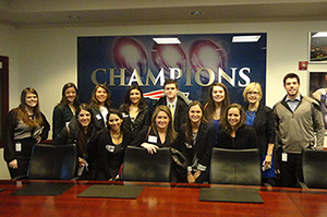 At the Kraft Sports Group are, front row from left, MBA student Allison D'Aprile '13, Valerie Podbelski '16, MBA student Jennifer Celli '14, Carley Pearson '18, and MBA student Laura Hasler '14, and rear, Kelly Donahue, marketing coordinator of the New England Patriots; Jamie Brown, '17; Molly Giudice '18; Lauren Chafizadeh '18; Nicholas Przekurat '17; Sara Ratto '15, Anne Lipsitz of the Center for Career Education; and Bobby Leonard, marketing coordinator at ESPNBoston.com.