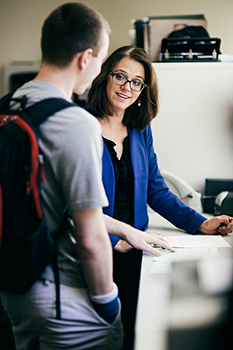 Image of a professor assisting a student