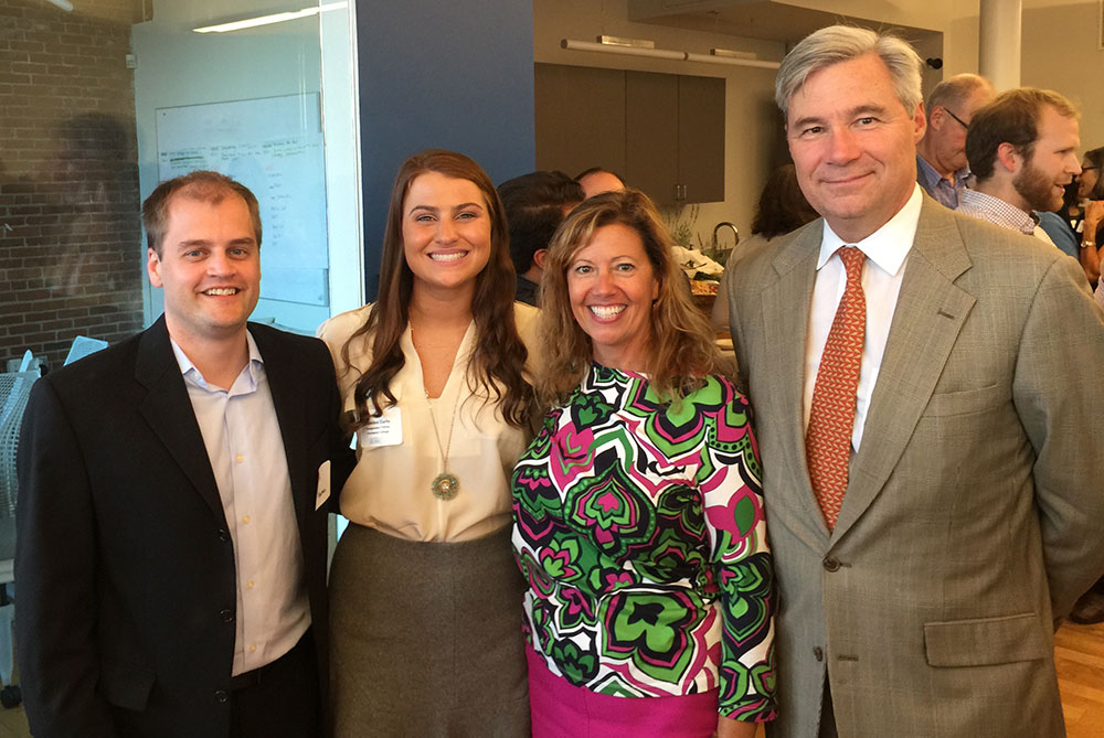 Madeline Curto (second from left), a junior marketing major, was honored for her Changemaker Fellowship appointment at a celebration co-hosted by Sen. Sheldon Whitehouse (right) on Monday, Sept. 14. Marketing faculty members Kevin Newman (left) and Rae Caloura (second from right) attended the celebration to support Madeline.