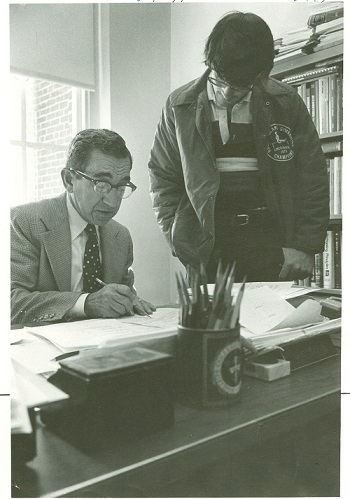 Gus Cote with a student