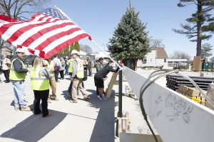 Students sign a beam at the Ryan Center Topping Off Ceremony.