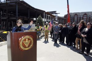 Dr. Sylvia Maxfield, Dean of the Providence College School of Business, speaks at the Ryan Center Topping Off Ceremony.