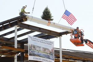 A beam is placed in the Ryan Center during the Topping Off Ceremony.