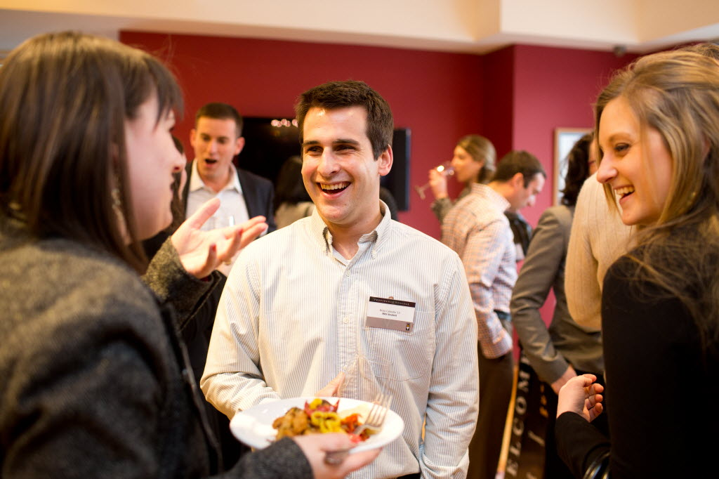 MBA alumni enjoy socializing at the MBA Program's Annual Alumni Wine Tasting.