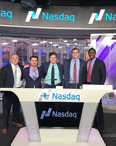 Providence College School of Business students and alumni at the Nasdaq Closing Bell