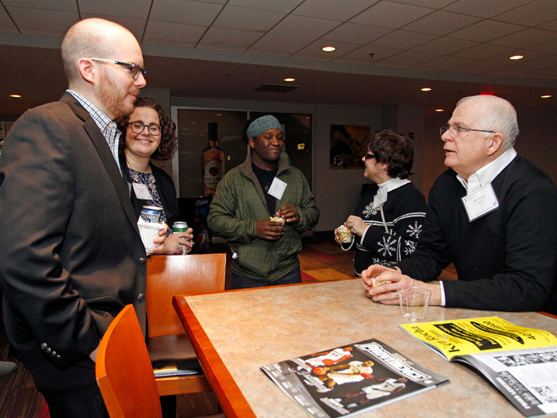 MBA students and alumni network with faculty and staff