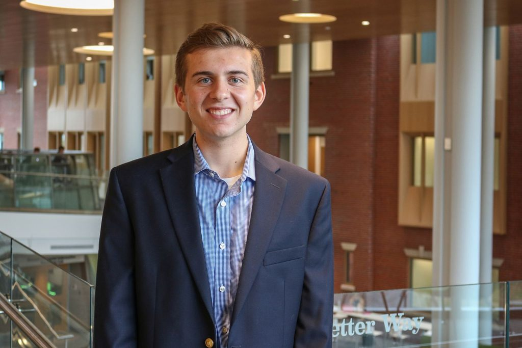 Kevin O'Neill '18 poses along Never Better Way in the new Ryan Center