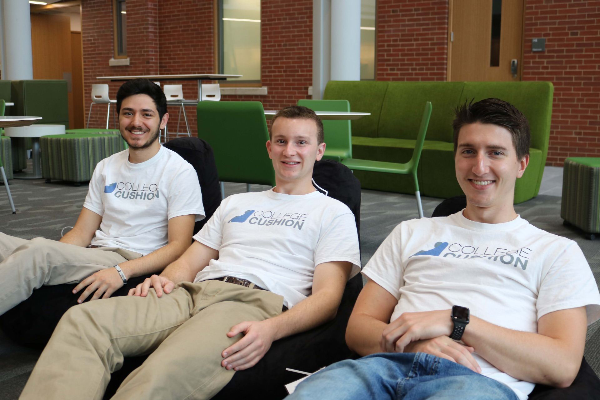 Michael Cruz '19, Shane Curran '19 and Andrew Drogan '19 sitting on their personalized bean bag chairs in Ryan.