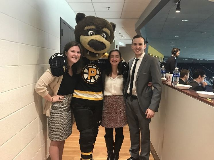 Katie Sullivan '18 with two other interns at her internship with the Providence Bruins.