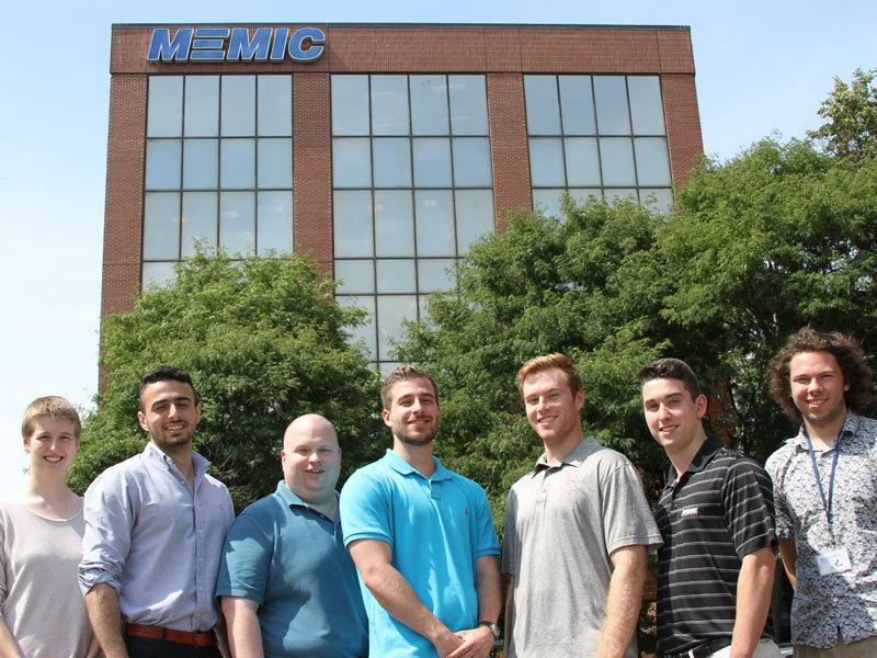 A group of interns outside MEMIC, Kerry Crepeau is second from the right.