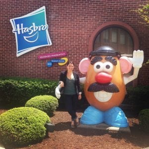 woman standing outside with an oversized Mr. Potato Head