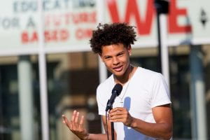 Student speaking at microphone