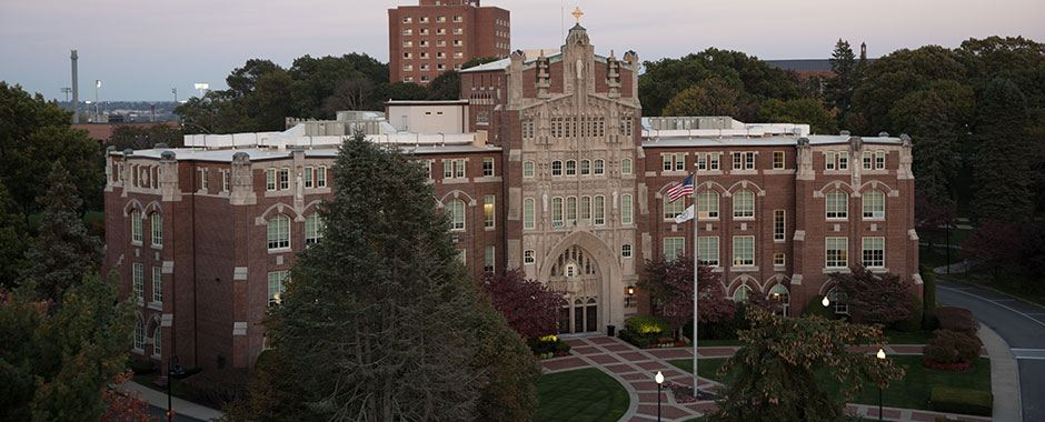 A view of Harkins Hall at sunset, the main administrative building on campus