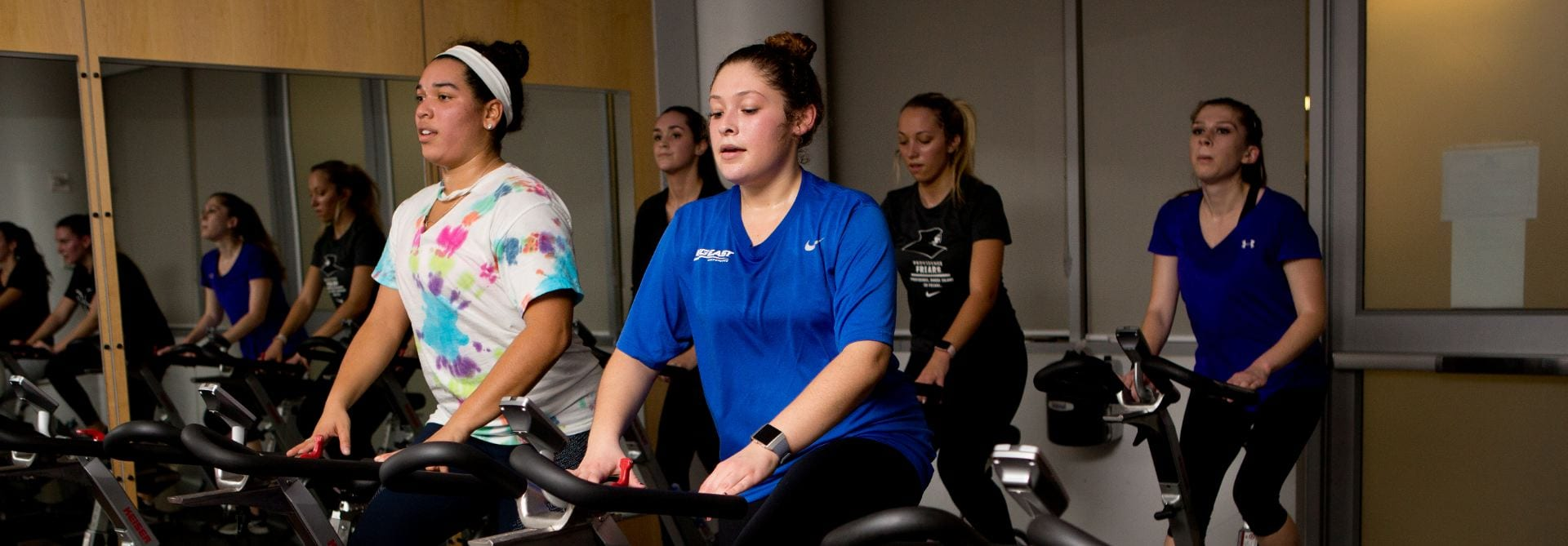 students on bikes at spin class