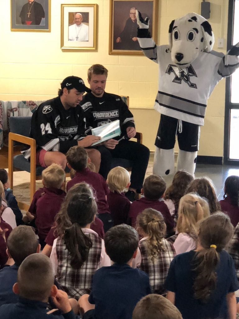 PC Hockey players reading to school children