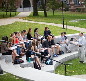 A dominican brother teaching class outside at PC