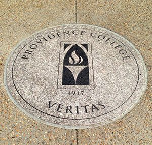 "Stone circle emblazoned with the providence college logo ""veritas"""