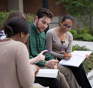 Students on campus studying together