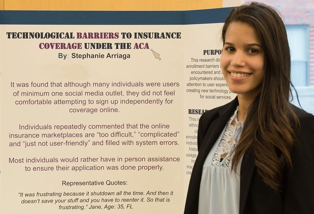 "HPM student presenting a poster entitled ""Technological Barriers to Insurance Coverage Under the ACA"""