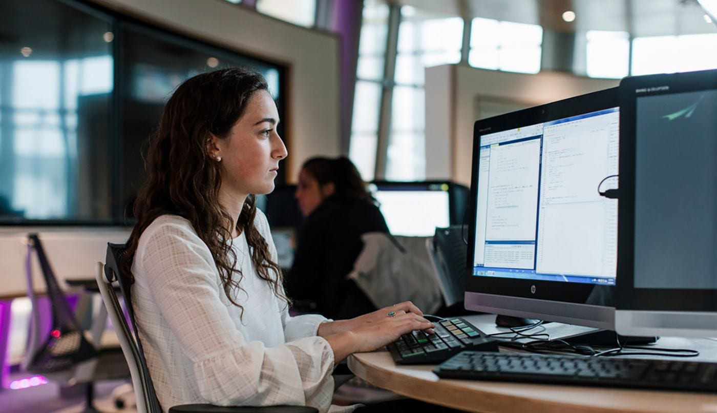 computer science banner image with female student in the ryan center