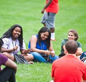 Students get to know each other on Slavin lawn during orientation