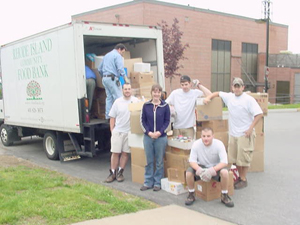 A crew helping load a food bank truck