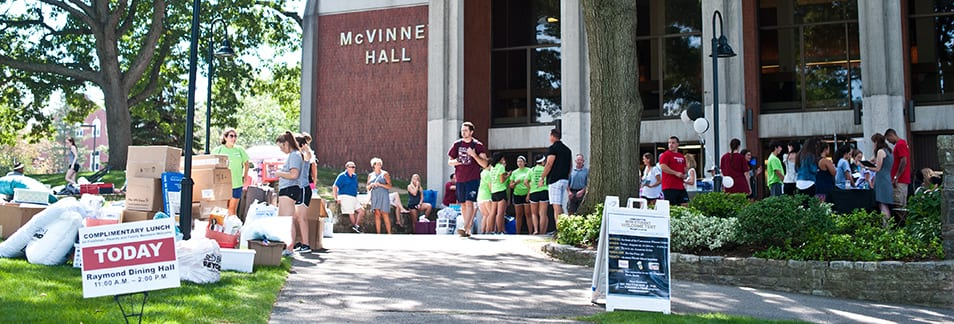 first year students outside McVinney Hall waiting to move in
