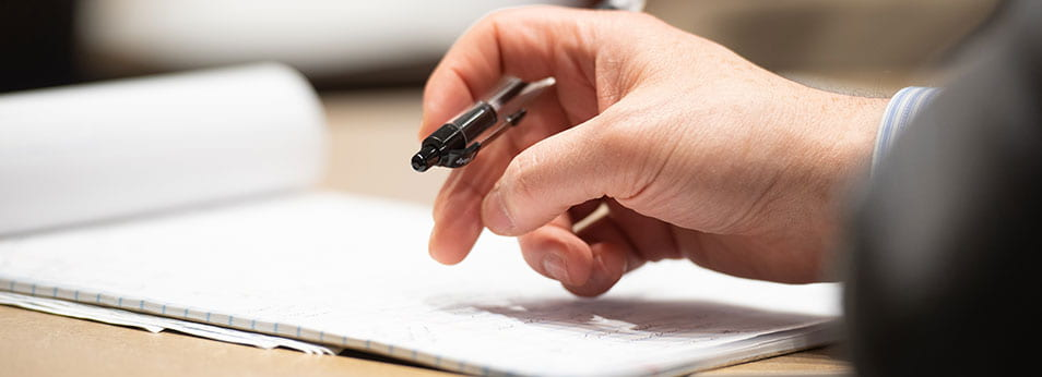Writing pad with handing holding pen