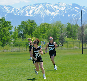 womens club lacrosse plways on field at nationals in colorado, mountains in background