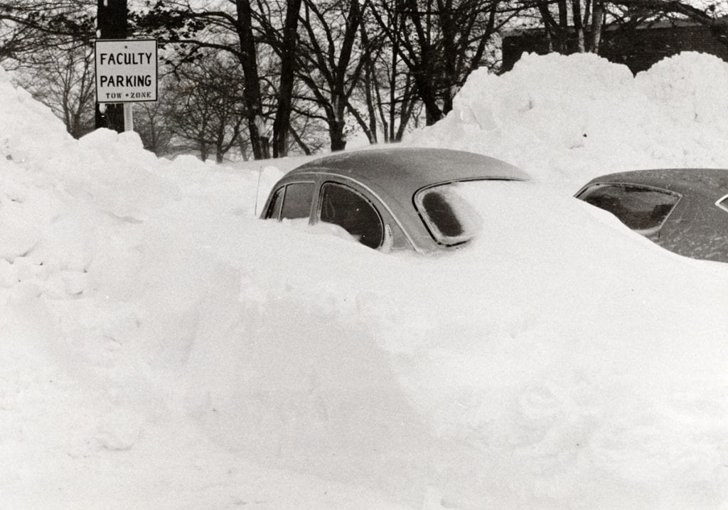 A volkswagon bug buried in snow